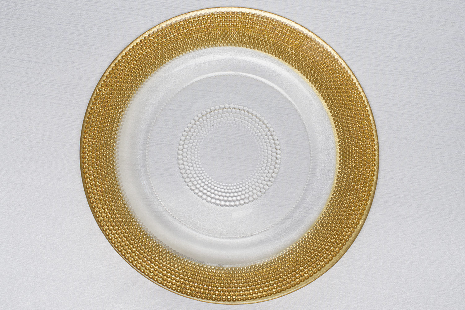 Gold variegated dots charger plate centerpiece table